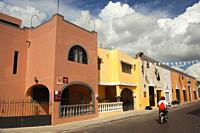 Motoryclist at the street in front of the colonial buildings in the historic center, Merida, Yucatan State, Mexico, Central America