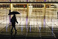Tel Aviv, Israel A person walking in the rain on Ha-bima Square.