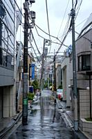 Deserted alley on a rainy day in Tokyo, Japan.