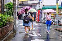 Scenes from the rainy streets of Tokyo, Japan in summer 2019.