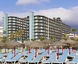 Torremolinos, Costa del Sol, Malaga Province, Andalusia, southern Spain. Rows of beach beds and umbrellas awaiting clients in the early morning on Pla...