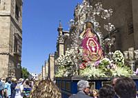 Cordoba, Cordoba Province, Andalusia, southern Spain. Religious procession in Calle Torrijas, passing by the western wall of the mosque. The historic ...