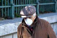 Old man wearing a face mask as he walk in the center of Athens. The total cases of confirmed coronavirus patients currently stands at 45 in Greece. Th...