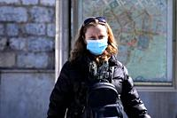 A woman wearing a face mask as she is going out of the metro station. The total cases of confirmed coronavirus patients currently stands at 45 in Gree...
