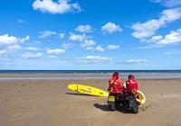Lifeguards sitting on quad bike at Saltburn by the sea, North Yorkshire, England. United Kingdom.