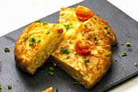 Spanish tortilla with tomatoes and chive.