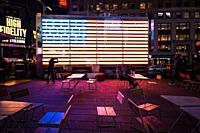 Times Square, is a busy tourist intersection of neon art and commerce and is an iconic street of New York City.