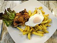 Roast chicken with egg, potatoes and salad.