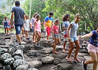 schoolchildren with teachers visit Arahurahu marae, Tahiti, French Polynesia.