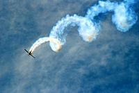 A stunt pilot demonstrates the corkscrew maneuver at an airshow at Jones Beach New York.
