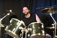 Musician Playing Drums And Cymbals At Concert .