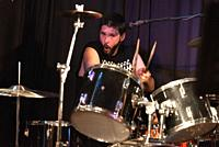 Male Musician Playing Drums And Cymbals At Concert .