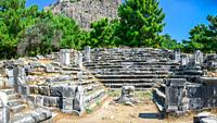 Ruins of the Bouleuterion or council house in the ancient city of Priene, Turkey, on a sunny summer day.
