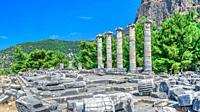 Ruins of the Temple of Athena Polias in the ancient city of Priene, Turkey, on a sunny summer day. Big panoramic shot.
