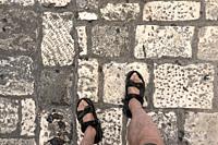 Feet on the street in Ostuni, Puglia, Italy.