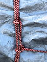 Rope knots over a tarp.