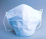 Typical three-layer protective surgical mask. The edge with double stitches is designed to cover the nose, and a metal wire is concealed within so the...