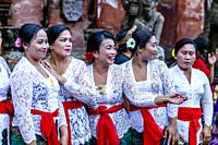 A Group Of Balinese Hindu Women In Traditional Dress At A Hindu Festival, Tirta Empul Water Temple, Bali, Indonesia.