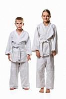 Full-length portrait of a boy and a girl of judo students.