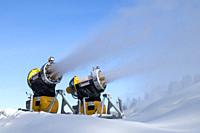snow cannons spraying artificial snow.