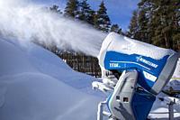 snow cannon spraying artificial snow.