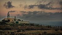 Mesa Roldan's lighthouse at sunset with grain vintage analog look, Carboneras, Almeria, Spain.