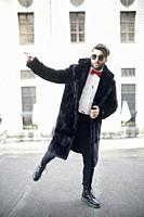 man showing direction of style