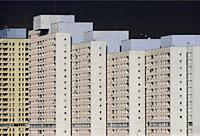 Europe, Poland, Lodz, March 2020, people isolated in their apartments during the coronavirus pandemic, here - Manhattan, skyscrapers district in cente...