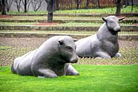 Sculptures of cattle in the Jing'an Sculpture Park , Shanghai, China.