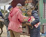 three men at the market at Ida Ougourd Market, near Essaouira, Morocco.