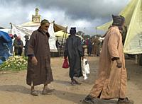 men in tradidional dress at the market in Ida Ougourd Market, near Essaouira, Morocco.