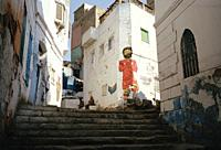 Street art of Liverpool and Egypt footballer Mo Salah in Islamic Cairo in the city of Cairo in Egypt in North Africa.