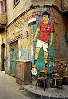 Street art of Egypt footballer Trezeguet in Islamic Cairo in the city of Cairo in Egypt in North Africa.