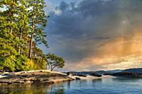 canoes on shell (midden) beach, Russell Island, Gulf Islands, British Columbia, Canada.