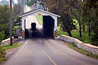 An Amish buggy makes its way through a covered bridge in Lancaster County, Pennsylvania.