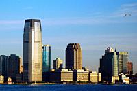 The buildings of the Jersey city, NJ skyline are built along the edge of the Hudson River.