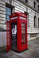 Essential London phone booth in its original color red.