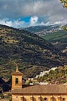 Church roof in front of the Alpujarra's mountain in winter, Ohanes, Spain.