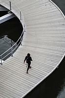 Stockholm, Sweden April 1, 2020 Pedestrians walking on the quay at Liljeholmskajen.