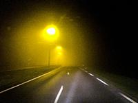 Den Bosch, Tilburg, Netherlands. Nightrider driving across the N265 local road towards home at night.