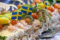 STOCKHOLM, SWEDEN A smorgastarta with shrimp and salmon. Literally a sandwich cake.