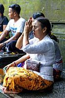 A Balinese Hindu Woman Praying At The Tirta Empul Water Temple, Bali, Indonesia.
