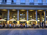 Paris, France, Crowd of People Sharing Drinks, Outside, in French Cafe terrace, Palais Royale Neighborhood ´Le Nemours´, Evening.