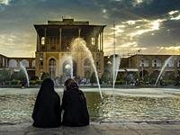 Naghsh-i Jahan Square, at dusk, when the Isfahan people go out to take the cool