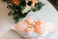gold wedding rings as an attribute of a young couple's wedding.