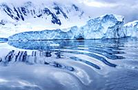 Iceberg Reflection Abstract Snow Mountains Blue Glaciers Dorian Bay Antarctic Peninsula Antarctica. Glacier ice blue because air squeezed out of snow.