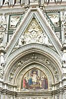 Architectural detail of the main entrance archway to Florence Cathedral (Cathedral of Santa Maria del Fiore) designed by Fillippo Brunelleschi, Centro...