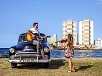 Cuban Couple with Vintage Chevrolet Car, Havana, La Habana Province, Cuba (MR).