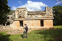 Visitor in front of the Palace in Mayan Archaeological Site Xlapak at the Puuc Route, Yucatan Province, Mexico, Central America