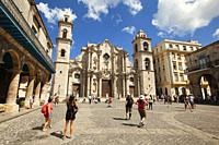 Tourists in front of the Cathedral in Plaza de la Catedral-Cathedral Square, Havana Vieja, Havana, Cuba, West Indies, Central America